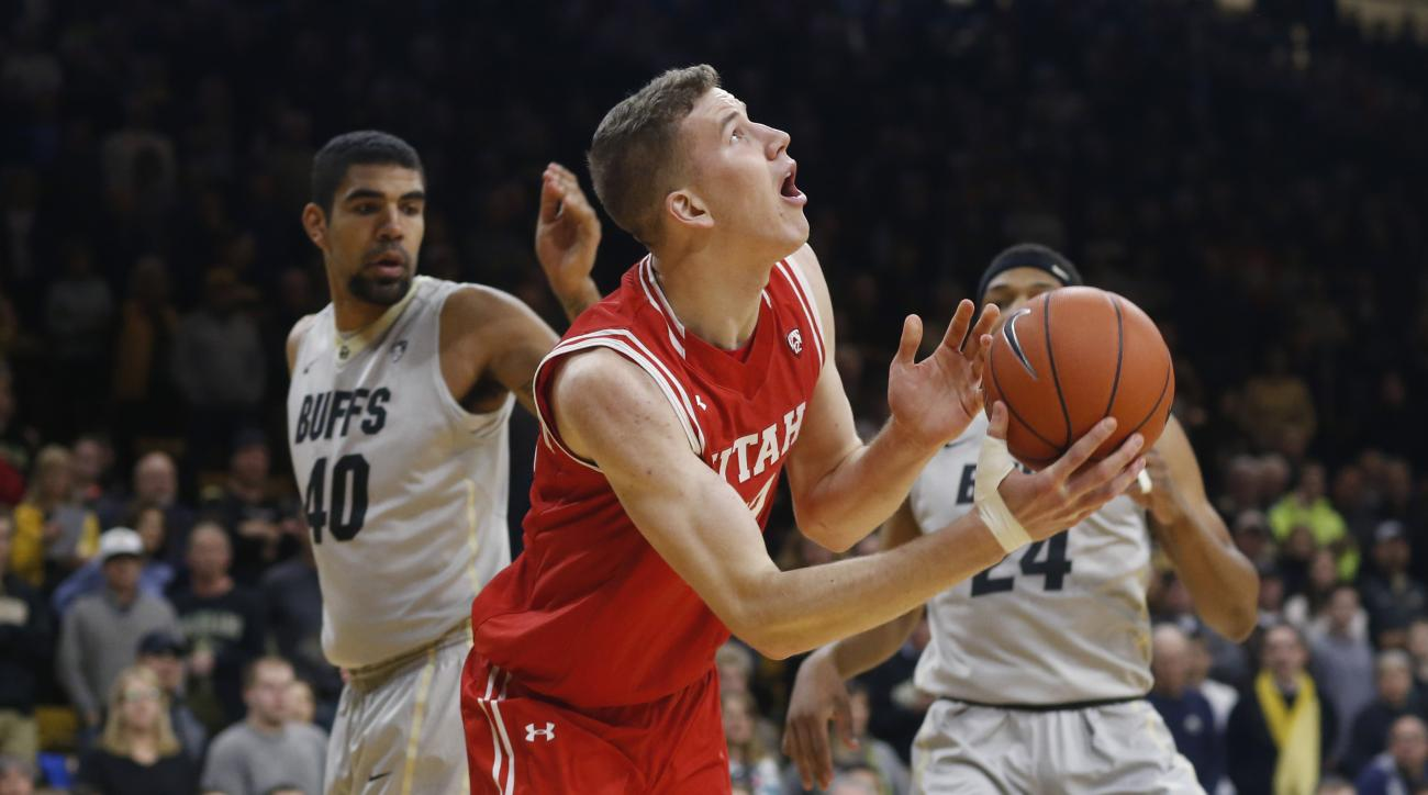 Utah forward Jakob Poeltl, front, goes up to shoot past Colorado forward Josh Scott, back left, and guard George King during the first half of an NCAA college basketball game  Friday, Jan. 8, 2016, in Boulder, Colo. (AP Photo/David Zalubowski)