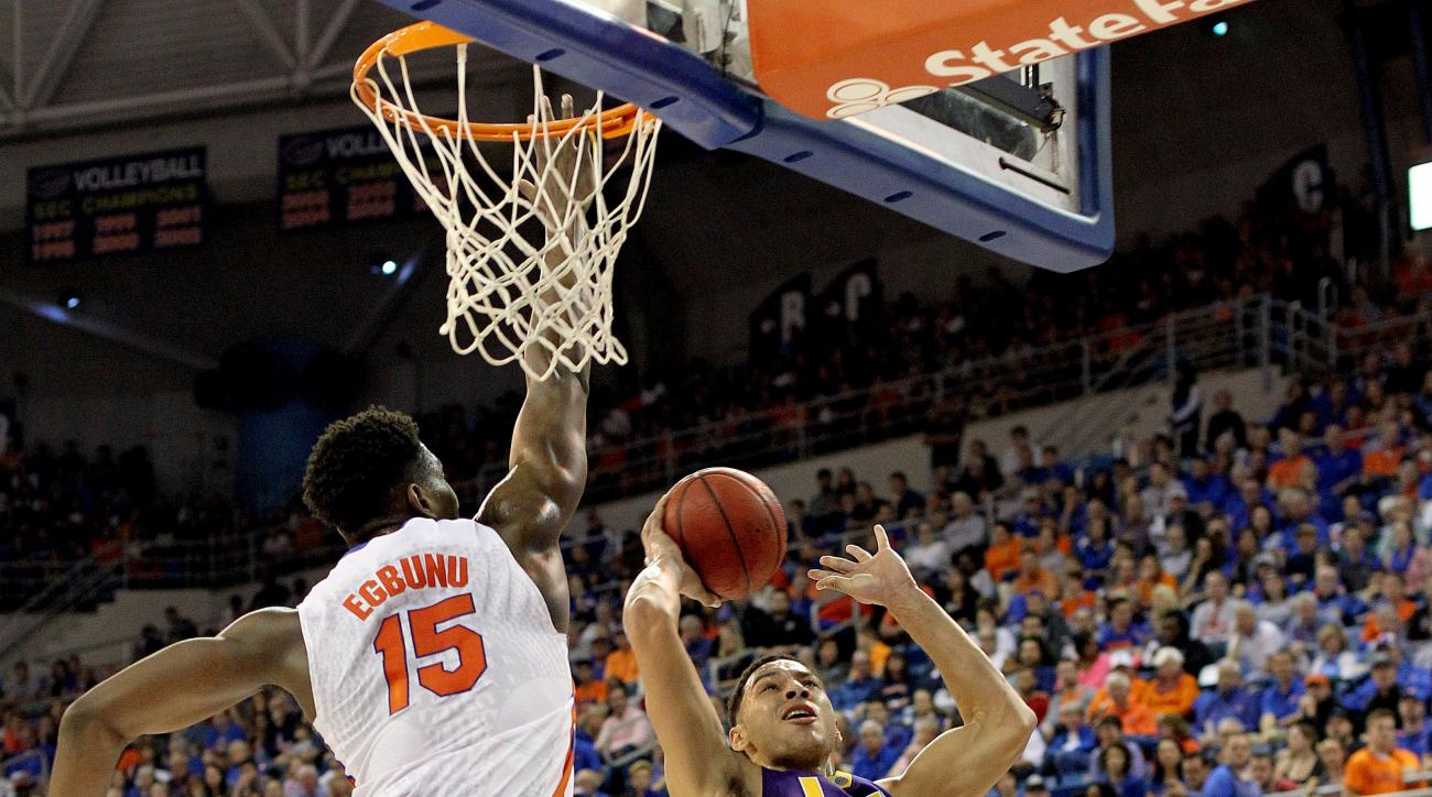 LSU forward Ben Simmons (25) takes a shot before being fouled by Florida center John Egbunu (15) during the first half of an NCAA college football game, Saturday, Jan. 9, 2016, in Gainesville, Fla. (Matt Stamey/The Gainesville Sun via AP)  THE INDEPENDENT