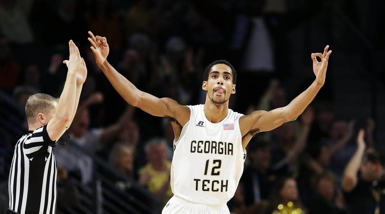 Georgia Tech's Quinton Stephens celebrates after hitting a three-point basket in the first half of an NCAA college basketball game against Virginia Saturday, Jan. 9, 2016, in Atlanta. (AP Photo/David Goldman)
