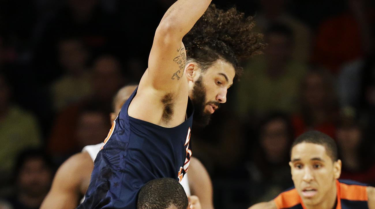 Georgia Tech's Marcus Georges-Hunt, right, dribbles against Virginia's Anthony Gill in the first half of an NCAA college basketball game Saturday, Jan. 9, 2016, in Atlanta. (AP Photo/David Goldman)