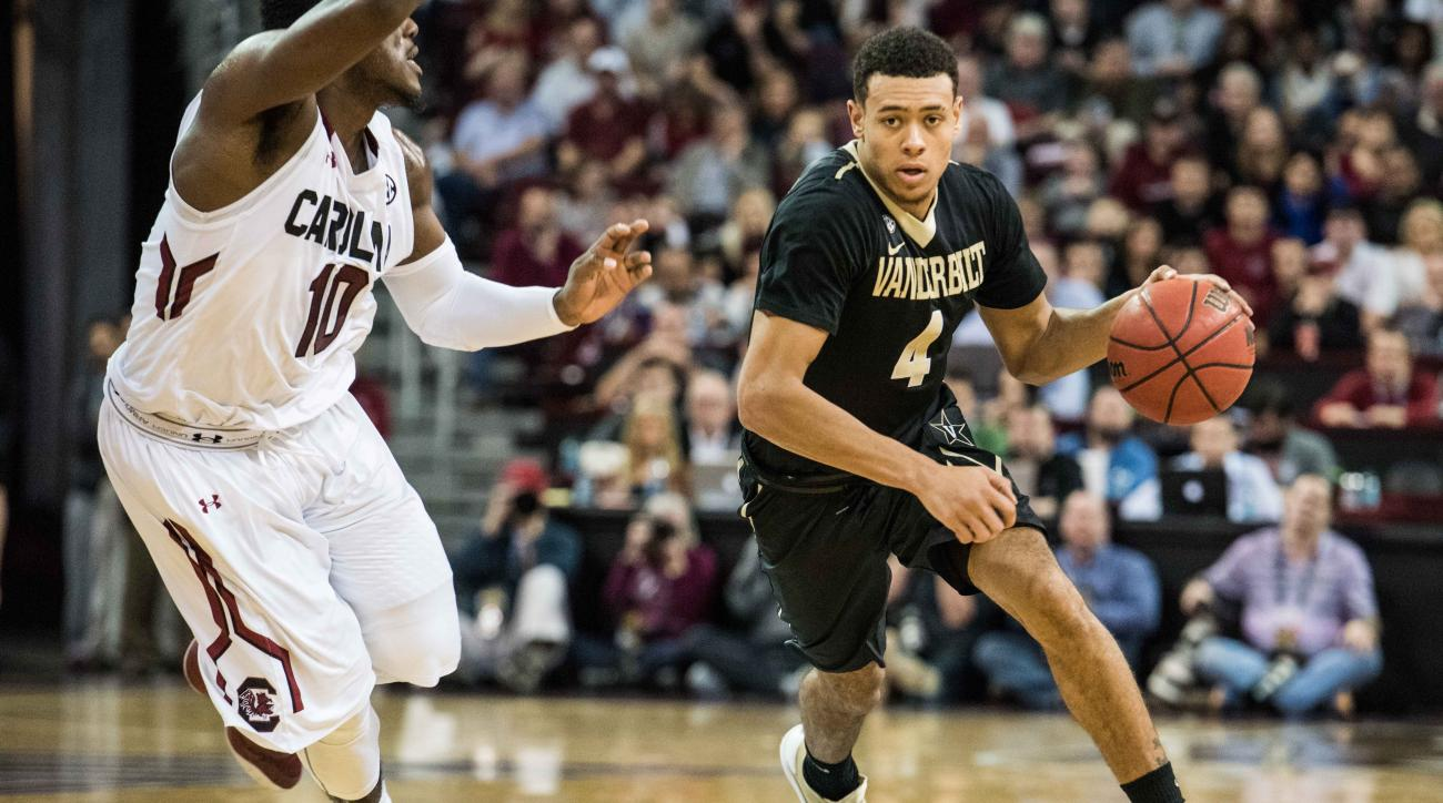 Vanderbilt guard Wade Baldwin IV (4) pushes the ball down court against South Carolina guard Marcus Stroman (10) during the first half of an NCAA college basketball game Saturday, Jan. 9, 2016, in Columbia, S.C.  (AP Photo/Sean Rayford)