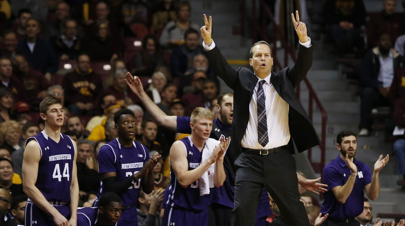 Northwestern head coach Chris Collins, right, calls out a play after his team scored a basket in the second half of an NCAA college basketball game against Minnesota, Saturday, Jan. 9, 2016, at Williams Arena in Minneapolis. Northwestern won 77-52. (AP Ph