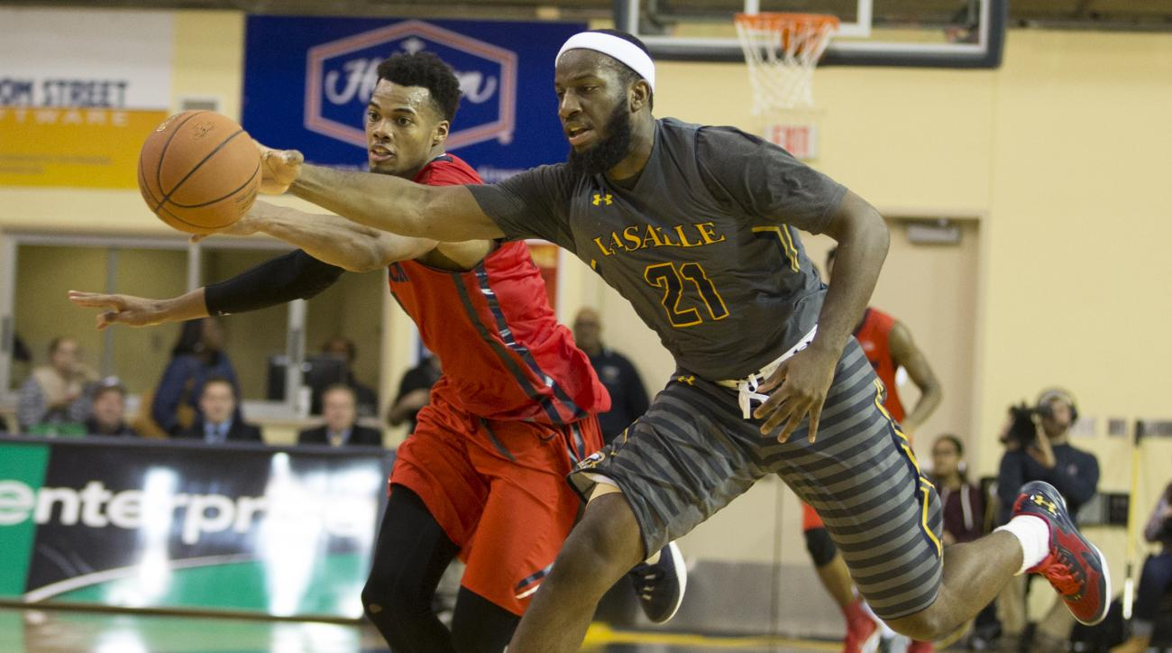 La Salle's Jordan Price, right and Dayton's Charles Cooke, left, go after the loose ball during the second half an NCAA basketball game, Saturday, Jan. 9, 2016, in Philadelphia. La Salle won 61-57. (AP Photo/Chris Szagola)