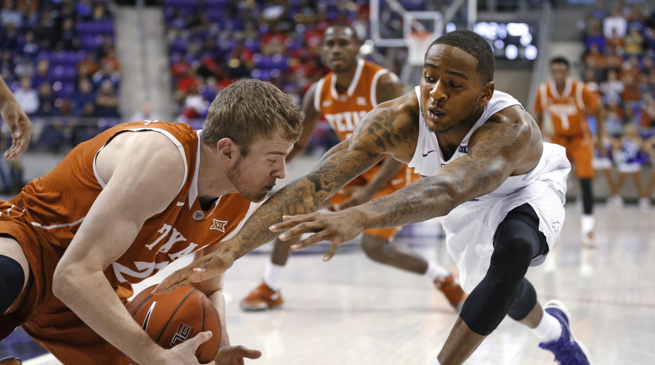 Texas forward Connor Lammert, left, grabs a loose ball next to TCU guard Malique Trent during the first half of an NCAA college basketball game Saturday, Jan. 9, 2016, in Fort Worth, Texas. (AP Photo/Ron Jenkins)