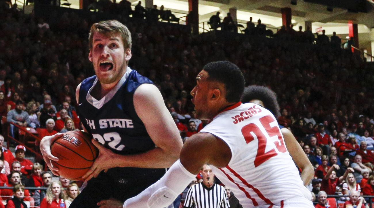 Utah State's Quinn Taylor (22) drives against New Mexico's Tim Jacobs (25) during the second half an NCAA college basketball game Saturday, Jan. 9, 2016, in Albuquerque, N.M. New Mexico won 77-59. (AP Photo/Juan Labreche)
