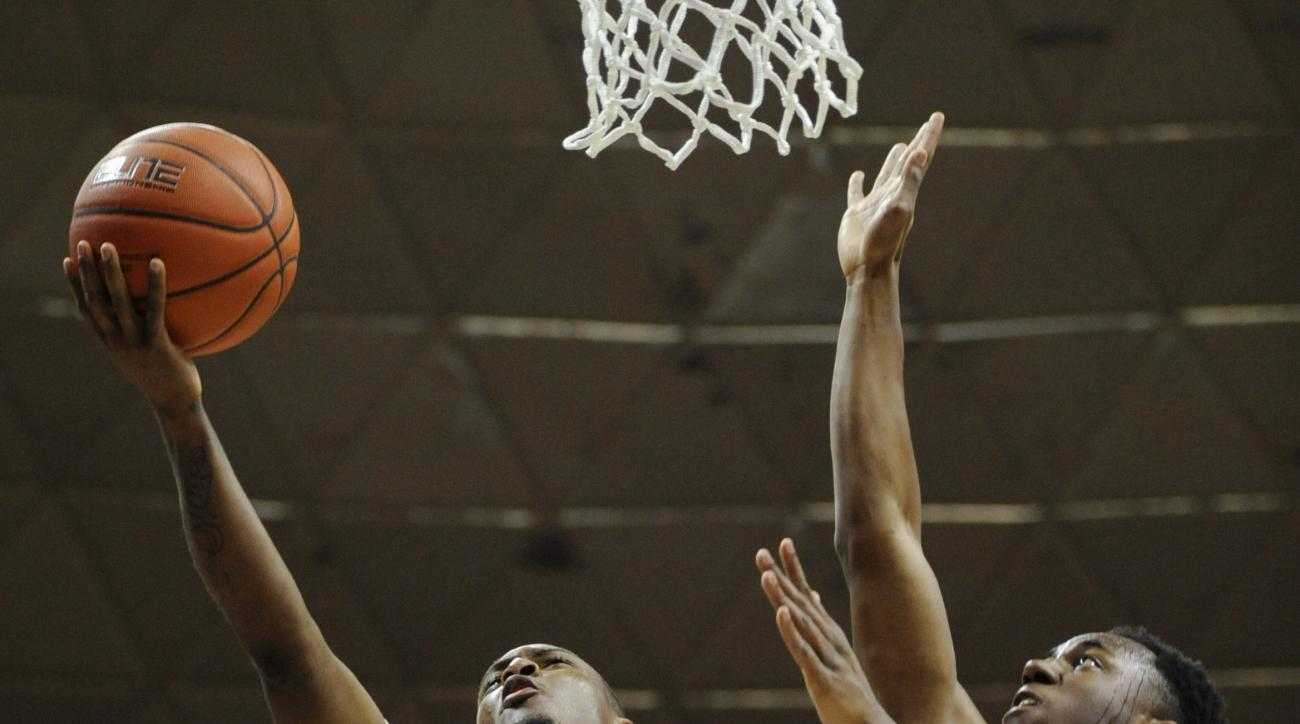 Connecticut's Sterling Gibbs shoots as Memphis' Avery Woodson, right, defends in the second half of an NCAA college basketball game, Saturday, Jan. 9, 2016, in Storrs, Conn. Gibbs had 26 points in UConn's win 81-78 over Memphis.  (AP Photo/Jessica Hill)