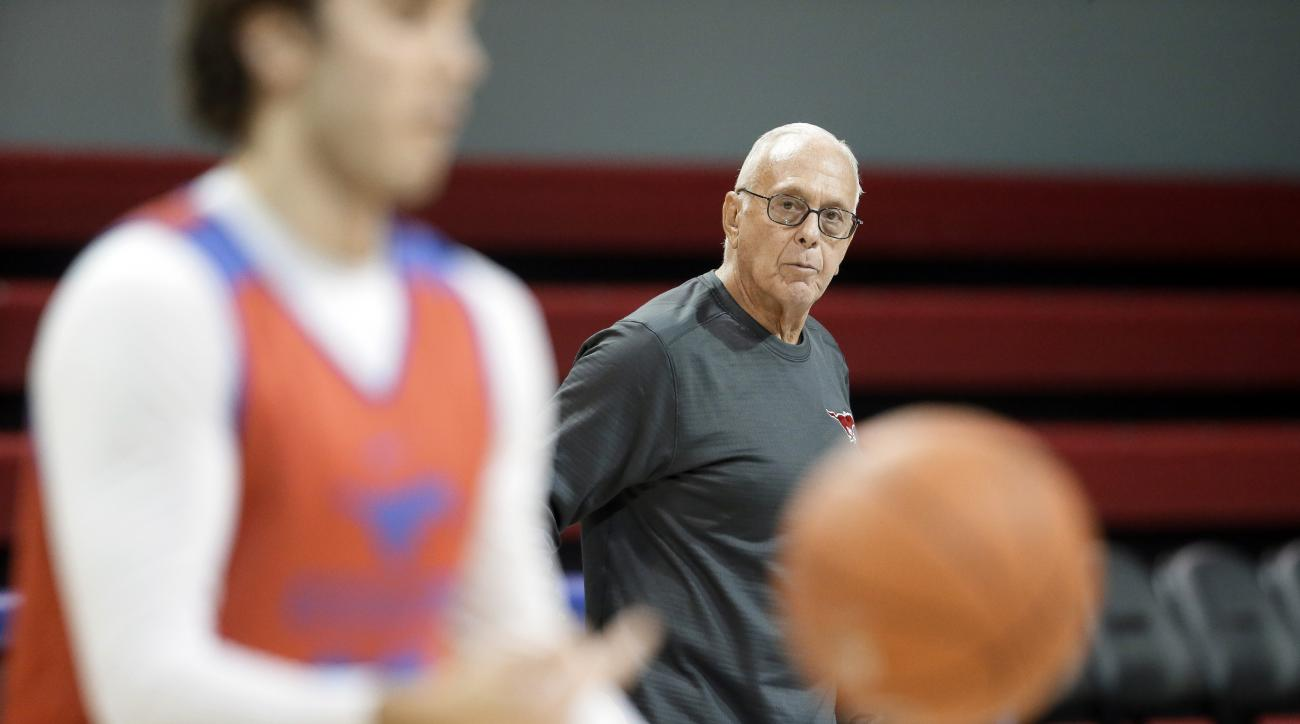 In this photo taken Monday, Jan. 11, 2016, SMU head basketball coach Larry Brown, rear, watches his team practice in Dallas. Tenth-ranked SMU will not return to the NCAA Tournament this season because of a postseason ban. So the Mustangs are looking to do