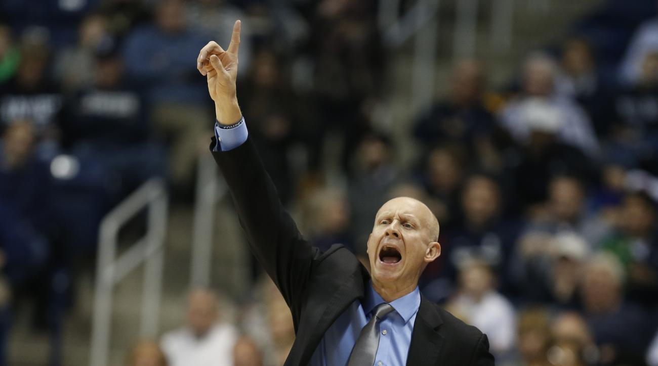 Xavier head coach Chris Mack shouts instructions during the first half of an NCAA college basketball game against DePaul, Tuesday, Jan. 12, 2016, in Cincinnati. (AP Photo/Gary Landers)