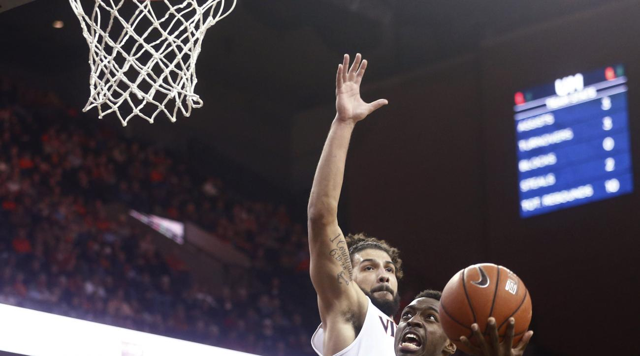 Miami guard Sheldon McClellan (10) shoots beyond Virginia forward Anthony Gill during the first half of an NCAA college basketball game in Charlottesville, Va., Tuesday, Jan. 12, 2016. (AP Photo/Ryan M. Kelly)
