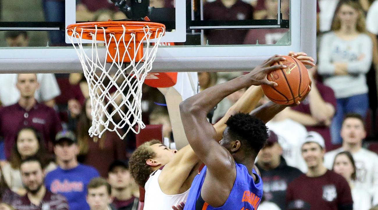Texas A&M's D.J. Hogg (1) blocks a shot by Florida's John Egbunu (15) during the first half of an NCAA college basketball game, Tuesday, Jan. 12, 2016, in College Station, Texas. (AP Photo/Sam Craft)
