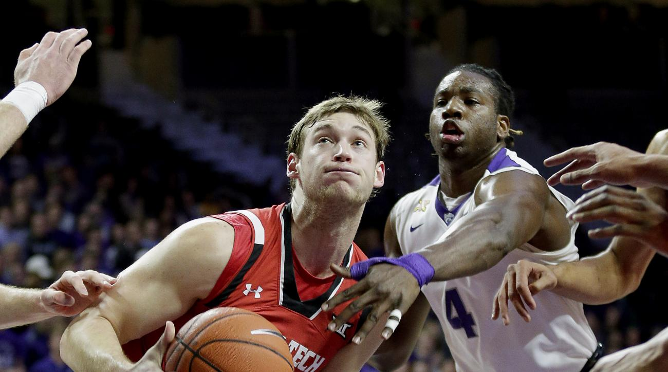 Kansas State's D.J. Johnson (4) tries to steal the ball from Texas Tech's Matthew Temple (34) during the first half of an NCAA college basketball game Tuesday, Jan. 12, 2016, in Manhattan, Kan. (AP Photo/Charlie Riedel)