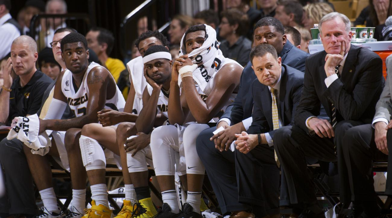 Missouri players and coaches watch the final minute of the team's 94-61 loss to Arkansas during the second half of an NCAA college basketball game, Tuesday, Jan. 12, 2016, in Columbia, Mo.  (AP Photo/L.G. Patterson)