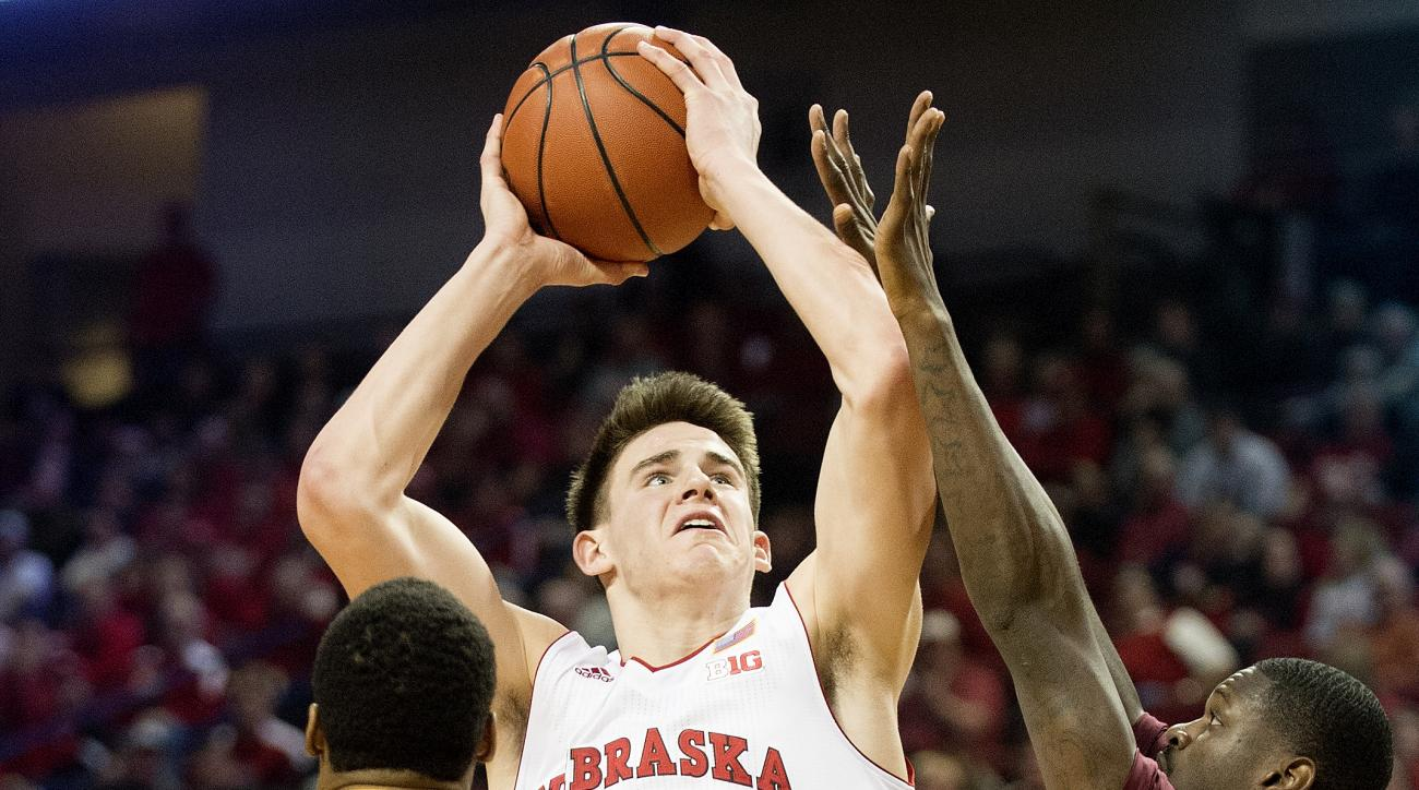 Nebraska forward Michael Jacobson (12) shoots between Minnesota forward Charles Buggs (23) and Carlos Morris during the second half of an NCAA college basketball game in Lincoln, Neb., Tuesday, Jan. 12, 2016. (Francis Gardler/The Journal-Star via AP) LOCA