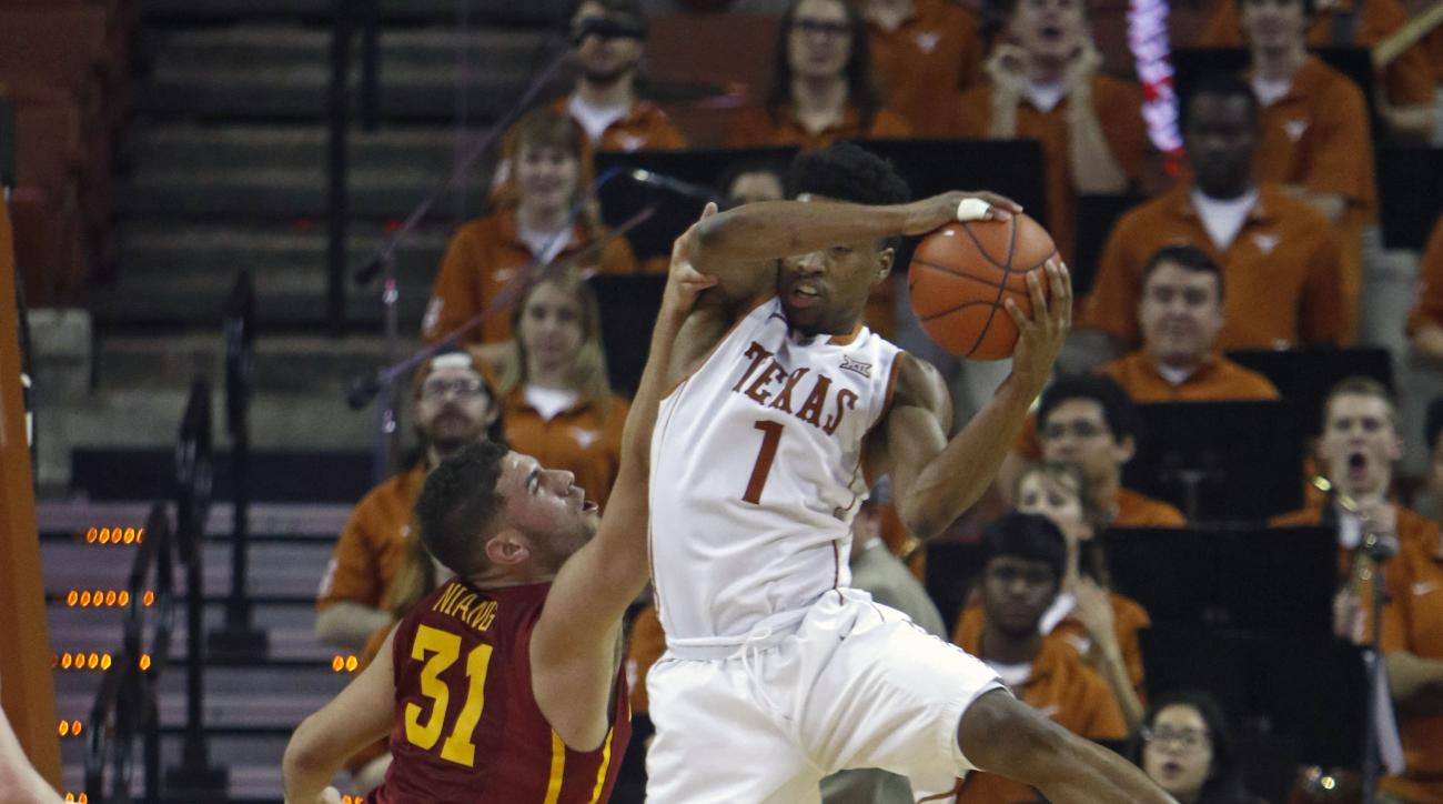 Texas guard Isaiah Taylor (1) gets a rebound against Iowa State forward Georges Niang (31) during the second half of an NCAA college basketball game, Tuesday, Jan. 12, 2016, in Austin, Texas. Texas won 94-91. (AP Photo/Michael Thomas)