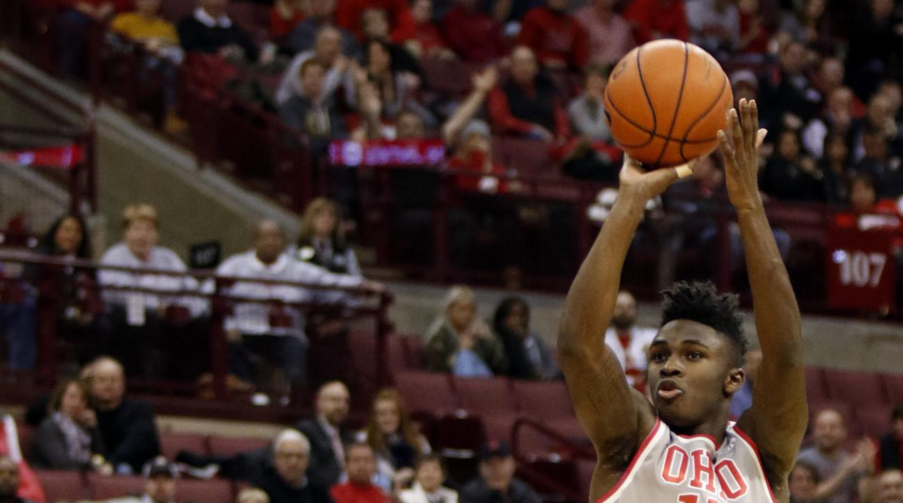 Ohio State's Kam Williams shoots over Rutgers' Justin Goode during the second half of an NCAA college basketball game in Columbus, Ohio, Wednesday, Jan. 13, 2016. Ohio State won 94-68. (AP Photo/Paul Vernon)