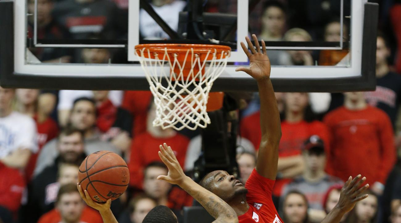 Cincinnati guard Troy Caupain (10) shoots against Houston forward Devonta Pollard (24) during the second half of an NCAA college basketball game Wednesday, Jan. 13, 2016, in Cincinnati. Cincinnati won 70-59. (AP Photo/Gary Landers)