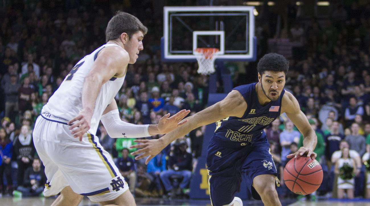 Georgia Tech's Josh Heath (11) drives by Notre Dame's Matt Ryan (4) during the first half of an NCAA college basketball game, Wednesday, Jan. 13, 2016, in South Bend, Ind.  (AP Photo/Robert Franklin)
