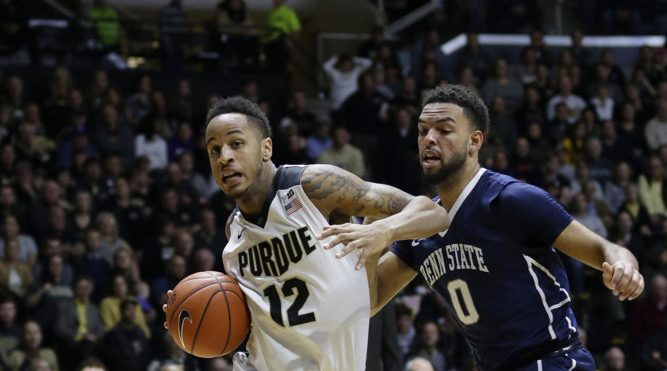 Purdue forward Vince Edwards (12) drives past Penn State forward Payton Banks (0) during the second half of an NCAA college basketball game in West Lafayette, Ind., Wednesday, Jan. 13, 2016. (AP Photo/Michael Conroy)