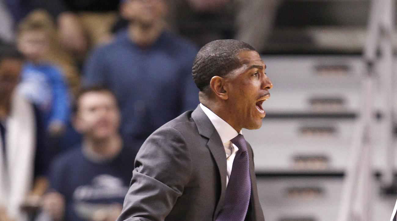 Connecticut head coach Kevin Ollie shouts instructions to his team during the first half of an NCAA college basketball game against Tulsa in Tulsa, Okla., Thursday, Jan. 14, 2016. (AP Photo/Dave Crenshaw)