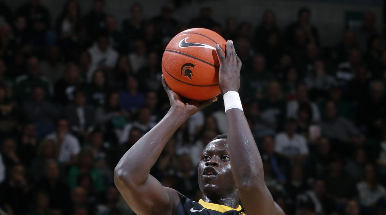 Iowa's Peter Jok (14) shoots over Michigan State's Denzel Valentine (45) during the first half of an NCAA college basketball game Thursday, Jan. 14, 2016, in East Lansing, Mich. (AP Photo/Al Goldis)