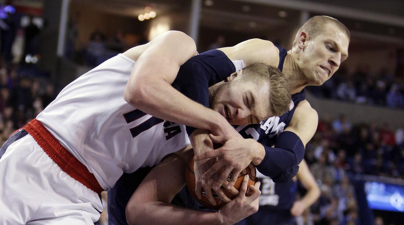 Gonzaga's Domantas Sabonis (11) and BYU's Nate Austin go after a rebound during the first half of an NCAA college basketball game, Thursday, Jan. 14, 2016, in Spokane, Wash. (AP Photo/Young Kwak)