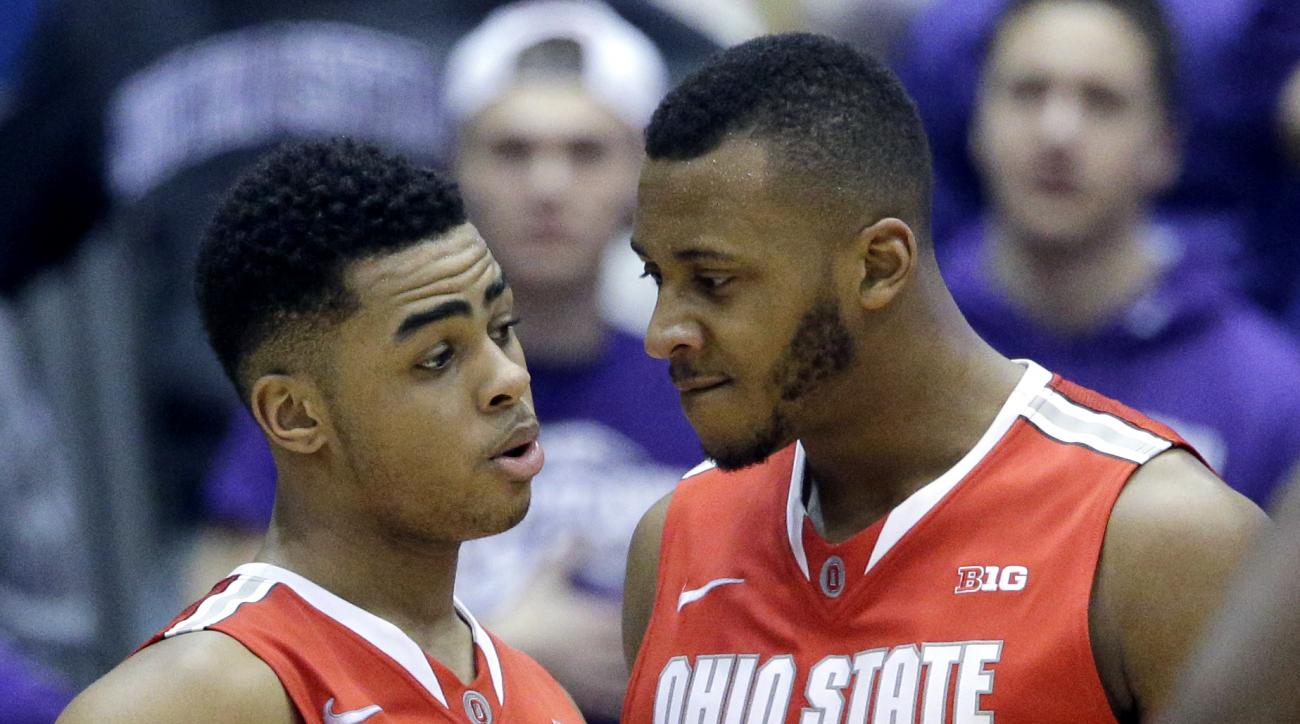 FILE - In this Jan. 22, 2015, file photo, Ohio State guard D'Angelo Russell (0) celebrates with center Trey McDonald (55) after scoring a basket during the second half of an NCAA college basketball game against Northwestern,  in Evanston, Ill. Ohio State