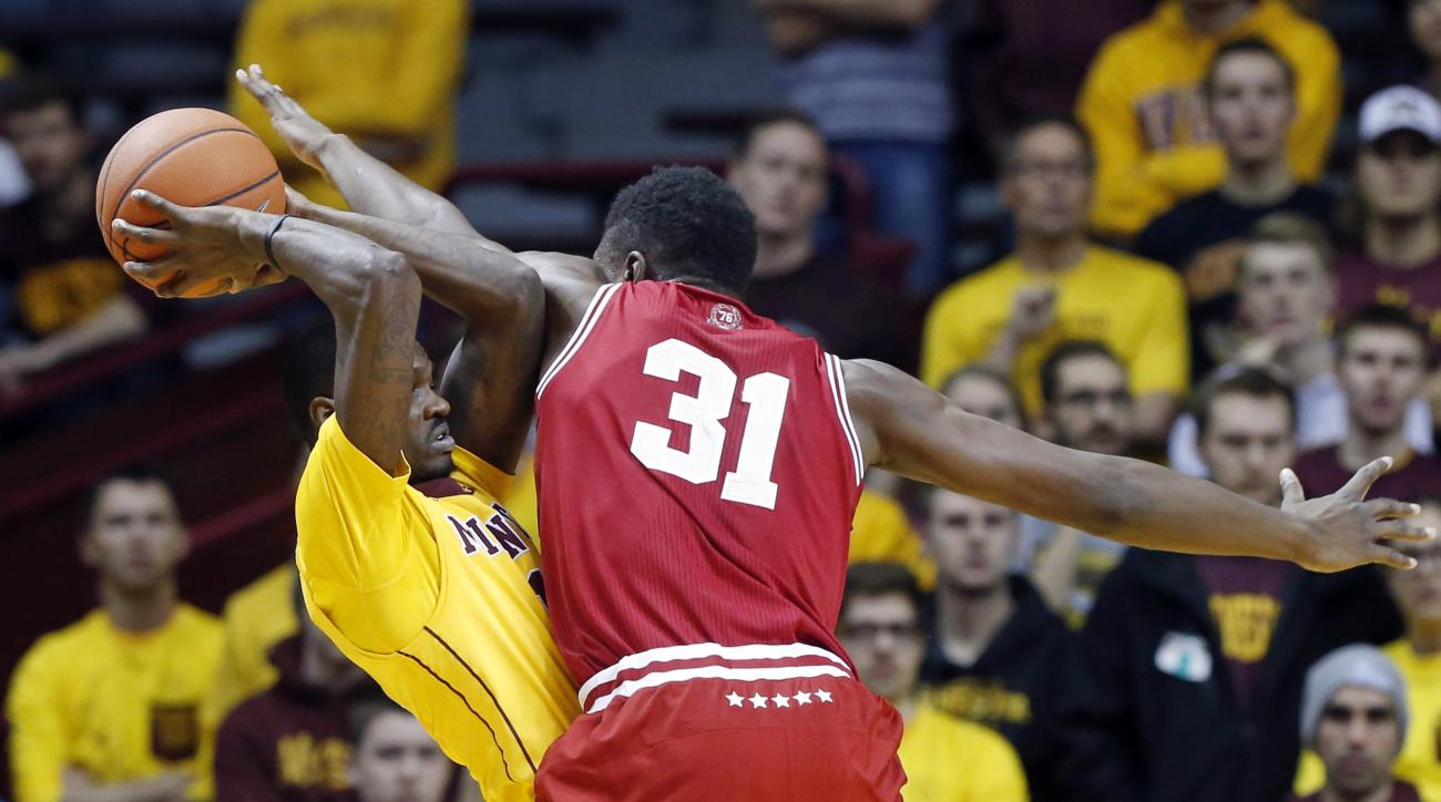 Indiana's Thomas Bryant, right, defends against Minnesota's Carlos Morris in the first half of an NCAA college basketball game, Saturday, Jan. 16, 2016, in Minneapolis.  (AP Photo/Jim Mone)