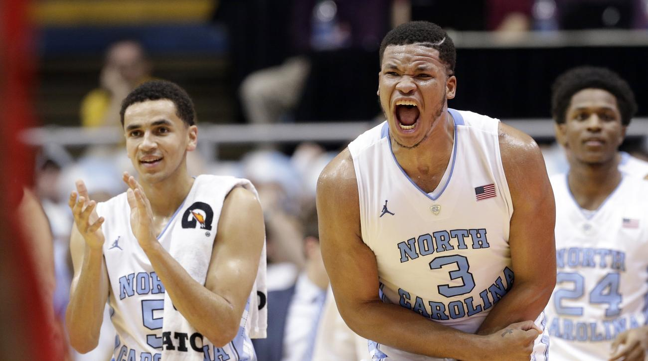 North Carolina's Kennedy Meeks (3) and Marcus Paige, left, react during the second half of an NCAA college basketball game against North Carolina State in Chapel Hill, N.C., Saturday, Jan. 16, 2016. North Carolina won 67-55. (AP Photo/Gerry Broome)