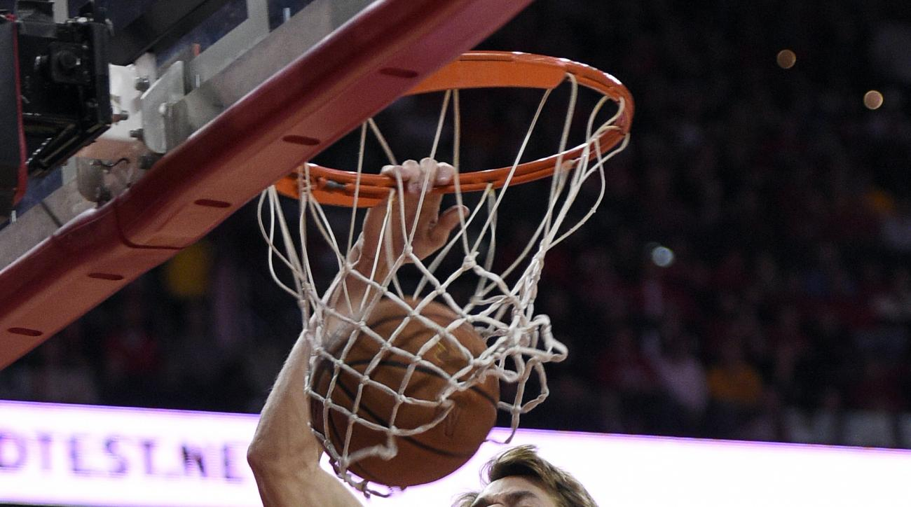 Maryland forward Jake Layman (10) dunks during the second half of an NCAA college basketball game against Ohio State, Saturday, Jan. 16, 2016, in College Park, Md. Maryland won 100-65. (AP Photo/Nick Wass)