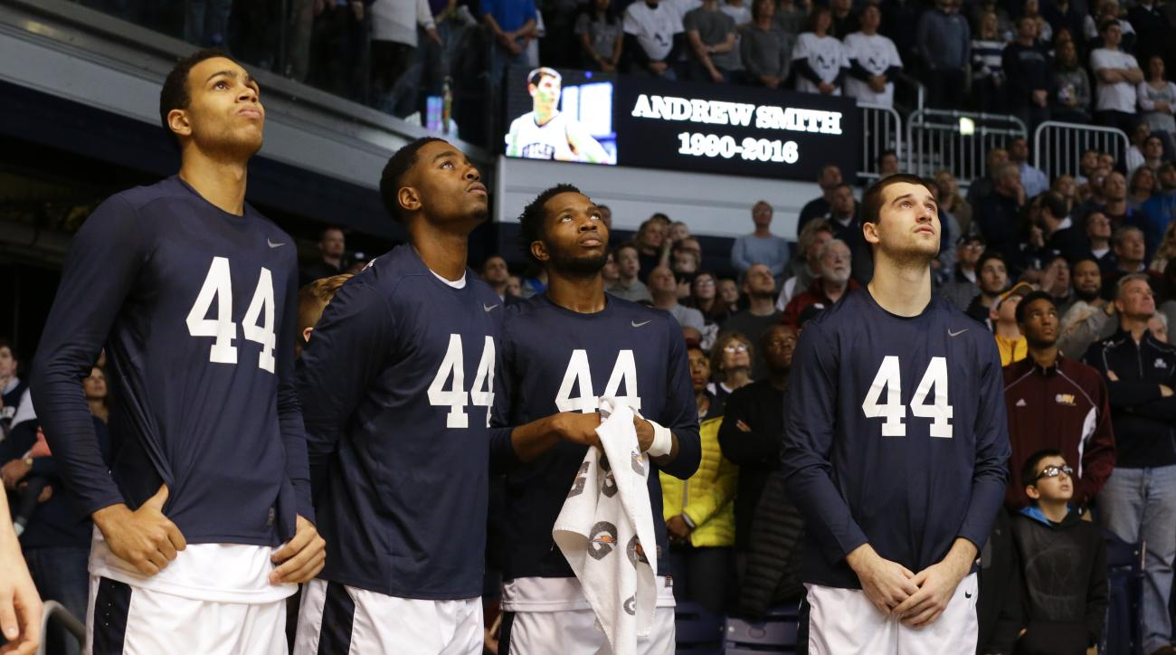 Butler players, left to right, Jackson Davis, Kelan Martin, Tyler Wideman, and Andrew Chrabascz watch a video tribute to former player Andrew Smith before an NCAA college basketball game against St. John's in Indianapolis, Saturday, Jan. 16, 2016. Smith d