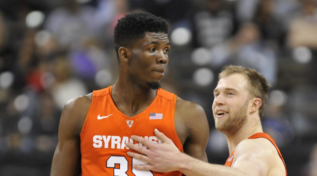 Syracuse guard Trevor Cooney (10) congratulates center Chinonso Obokoh (35) during an NCAA college basketball game at Joel Coliseum in Winston-Salem, N.C., Saturday Jan. 16, 2016.  (Bruce Chapman/The Winston-Salem Journal via AP) MANDATORY CREDIT  MBI(