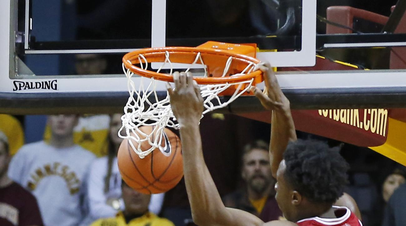 Indiana's OG Anunoby, right, dunks as Minnesota's Kevin Dorsey watches in the second half of an NCAA college basketball game, Saturday, Jan. 16, 2016, in Minneapolis. Indiana won 70-63. (AP Photo/Jim Mone)