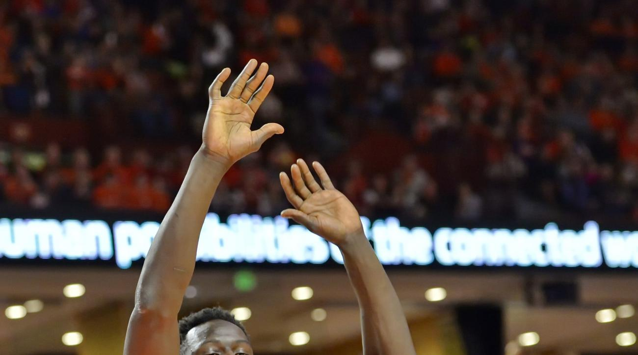 Miami's Tonye Jekiri drives in against Clemson's Sidy Djitte during the first half of an NCAA college basketball game Saturday, Jan. 16, 2016, in Greenville, S.C. (AP Photo/Richard Shiro)
