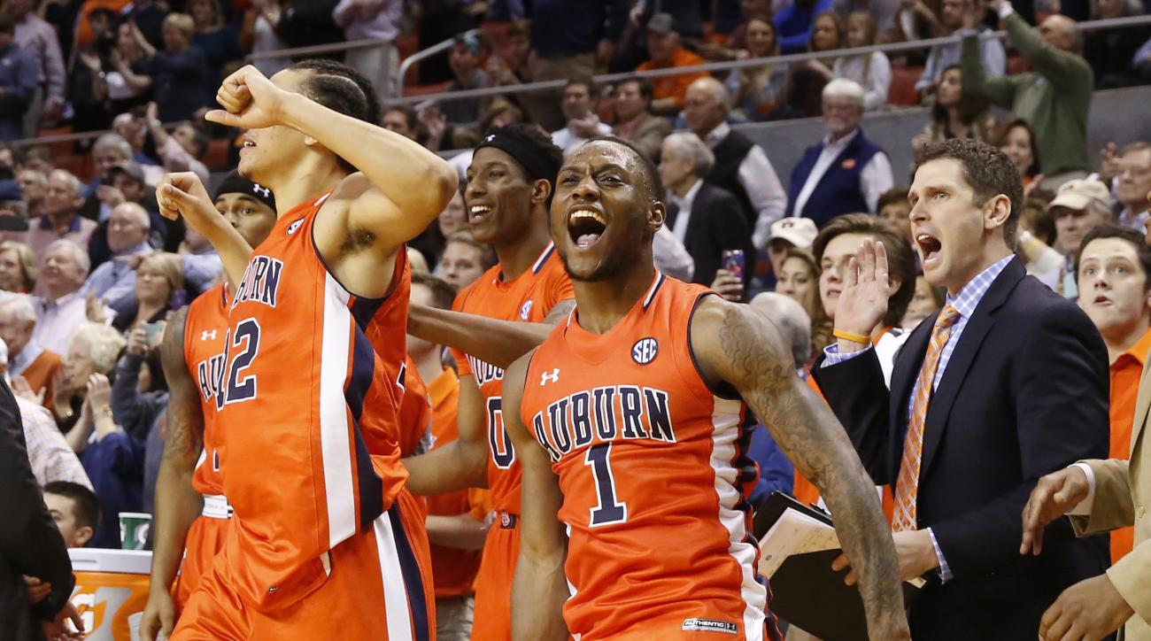 Auburn guard Kareem Canty (1) celebrates after beating Kentucky 75-70 after an NCAA college basketball game, Saturday, Jan. 16, 2016, in Auburn, Ala. (AP Photo/Brynn Anderson)