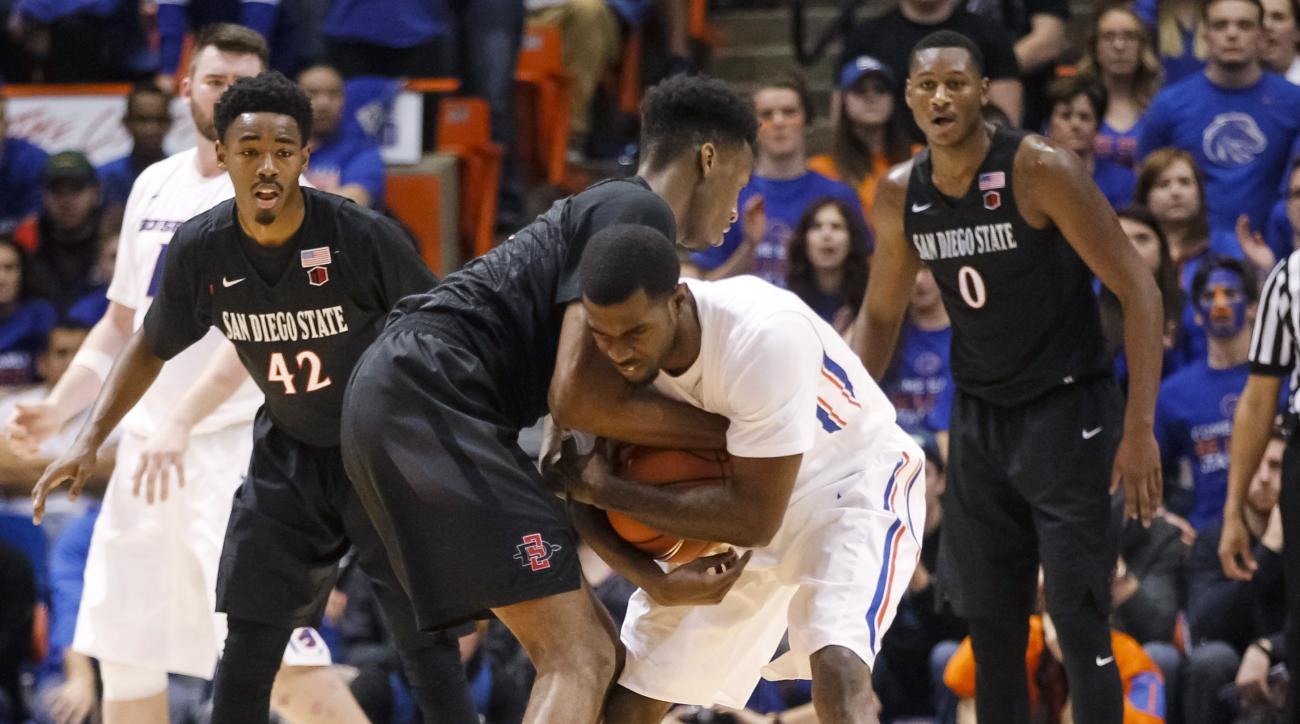 Boise State's Mikey Thompson, right, and San Diego State's Dakarai Allen tussle over a jump ball during the first half of an NCAA college basketball game in Boise, Idaho, on Saturday, Jan. 16, 2016. (AP Photo/Otto Kitsinger)