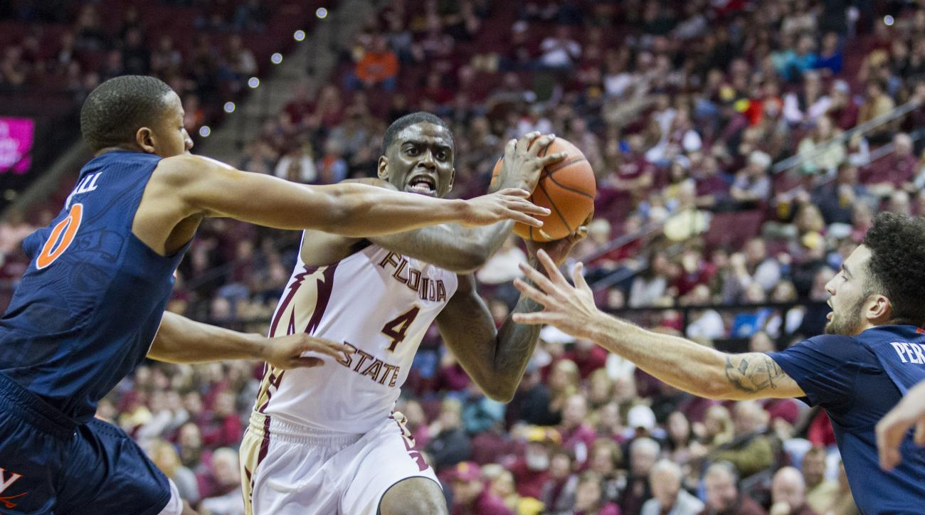 Florida State guard Dwayne Bacon, Jr. (4) drives to the basket against Virginia's Devon Hall, left, and London Perrantes in the first half of an NCAA college basketball game in Tallahassee, Fla., Sunday, Jan. 17, 2016. (AP Photo/Mark Wallheiser)