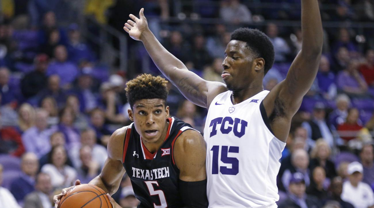 Texas Tech forward Justin Gray (5) gets past TCU forward JD Miller (15) during the first half of an NCAA college basketball game, Monday, Jan. 18, 2016, in Fort Worth, Texas. (AP Photo/Ron Jenkins)