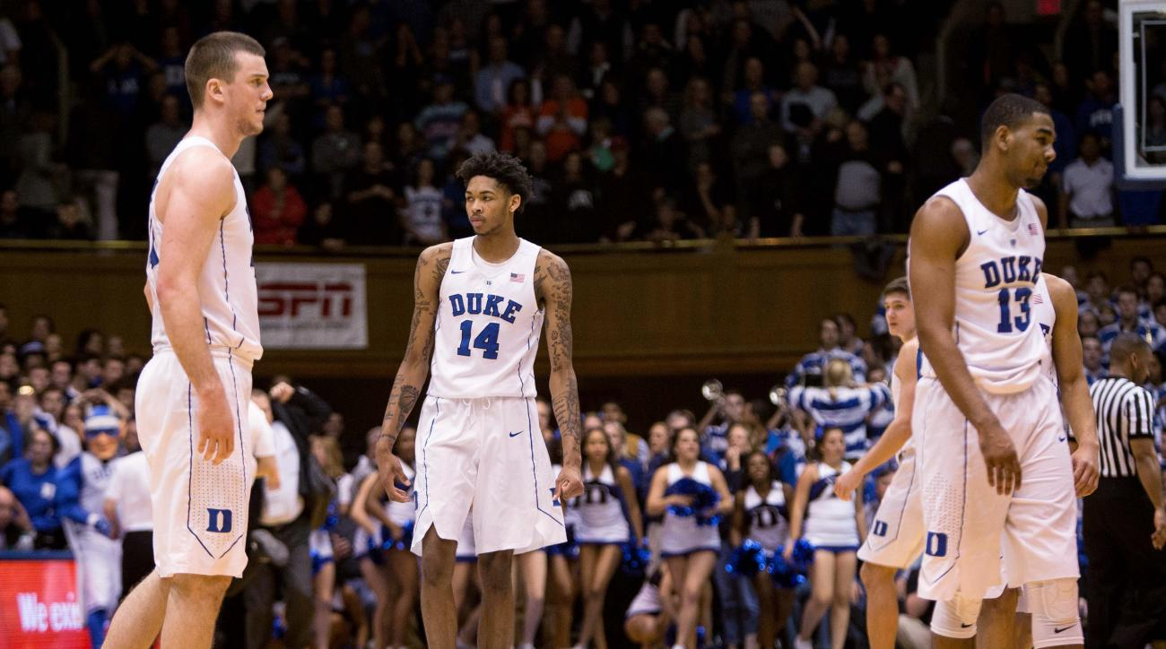 Duke's Marshall Plumlee, left, Brandon Ingram (14), Grayson Allen, second from right, and Matt Jones (13) walk off the court following an NCAA college basketball game against Syracuse at Cameron Indoor Stadium in Durham, N.C., Monday, Jan. 18, 2016. Syrac