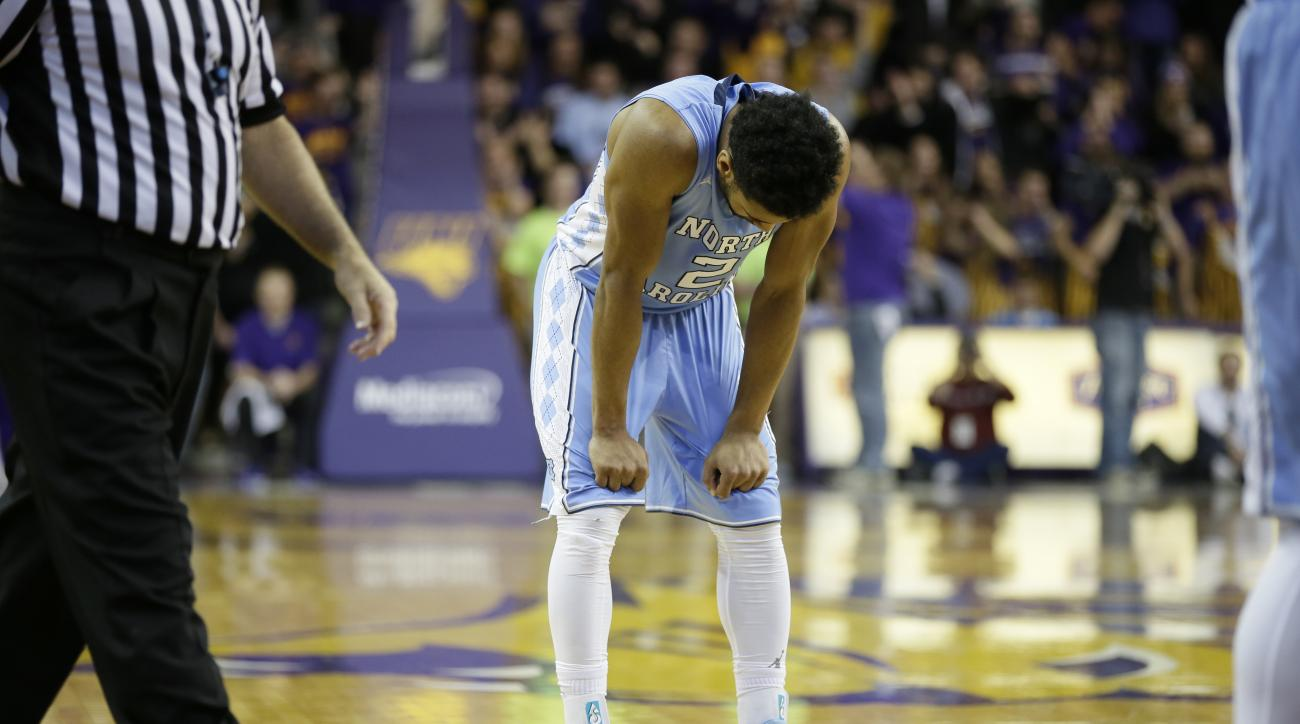 FILE - In this Nov. 21, 2015, file photo, North Carolina guard Joel Berry II reacts at the end of an NCAA college basketball game against Northern Iowa,  in Cedar Falls, Iowa. Northern Iowa won 71-67. No college basketball season is complete without upset