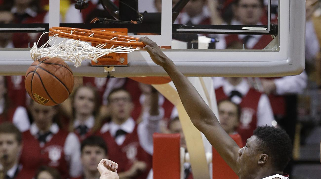 Indiana's Thomas Bryant dunks against Illinois' Michael Finke (43) during the first half of an NCAA college basketball game Tuesday, Jan. 19, 2016, in Bloomington, Ind. (AP Photo/Darron Cummings)