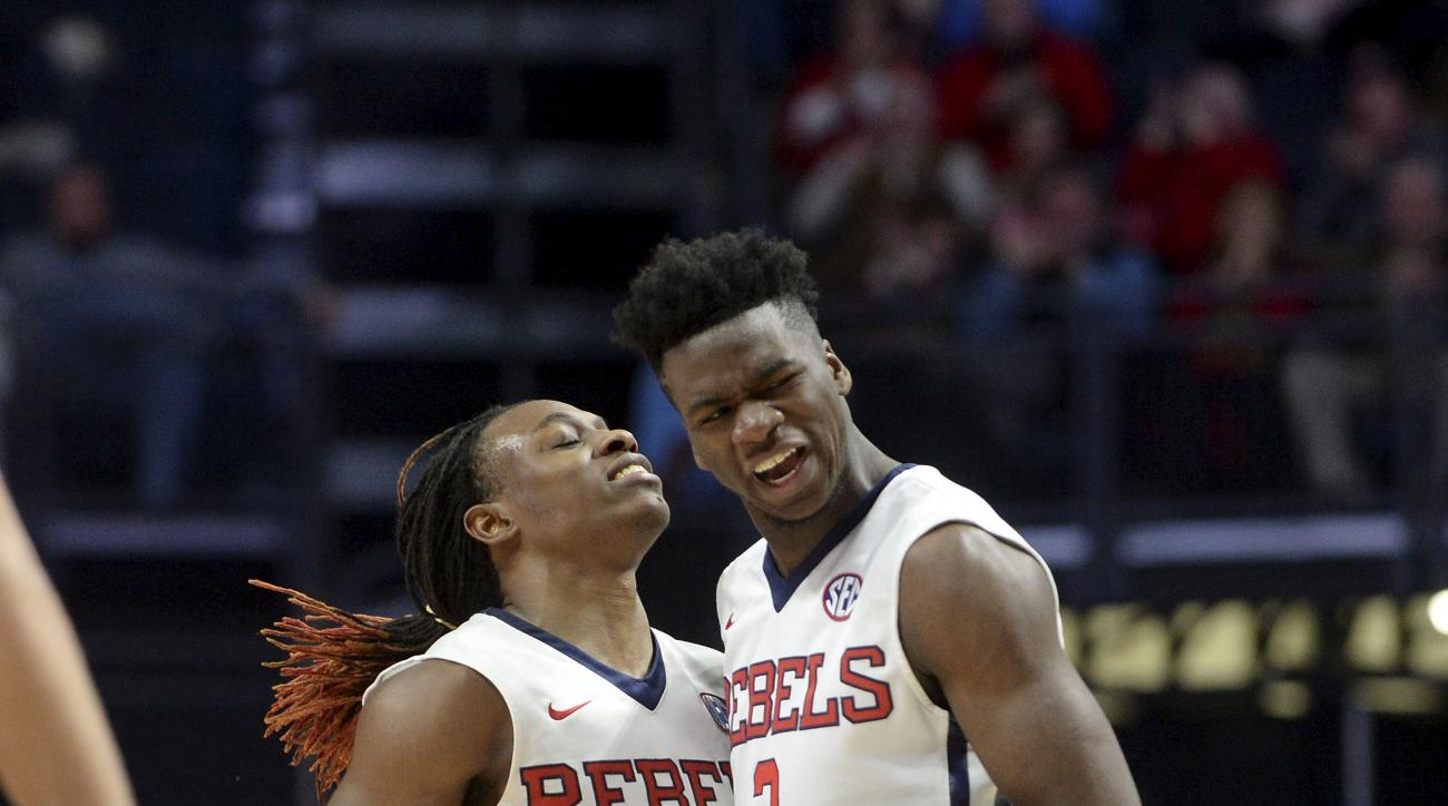 Mississippi guard Stefan Moody (42) and guard Terence Davis (3) react after a basket by Moody during the first half of an NCAA college basketball game against South Carolina in Oxford, Miss., Tuesday, Jan. 19, 2016. (AP Photo/Thomas Graning)
