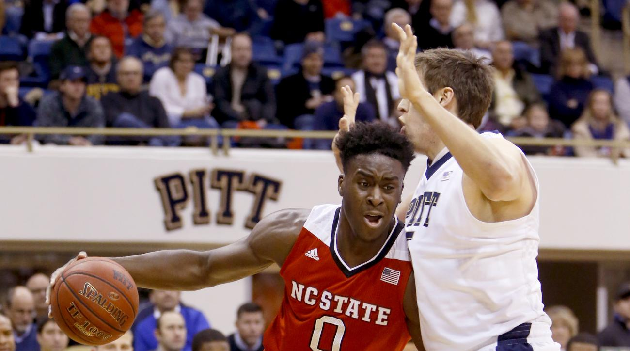 North Carolina State's Abdul-Malik Abu drives on Pittsburgh's Rafael Maia during the first half of an NCAA college basketball game Tuesday, Jan. 19, 2016, in Pittsburgh. (AP Photo/Keith Srakocic)