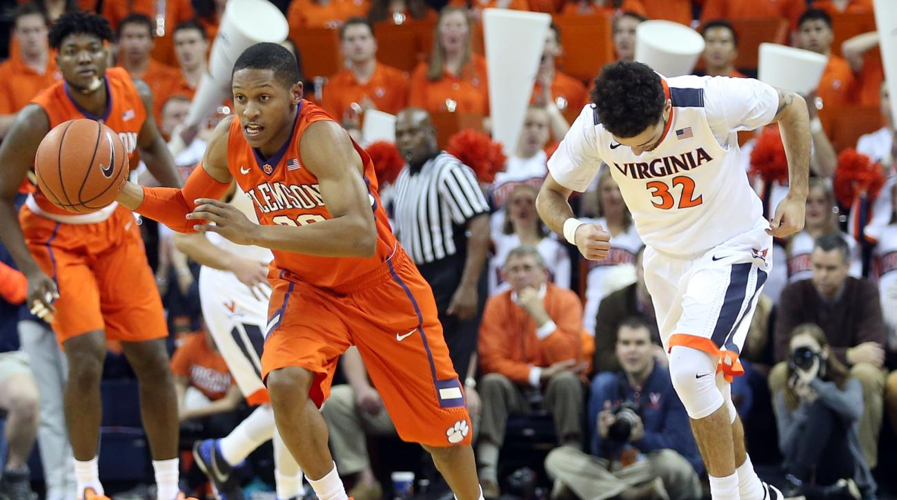 Clemson guard Jordan Roper (20) steals the ball from Virginia guard London Perrantes (32) during an NCAA college basketball game Tuesday Jan. 19, 2016, in Charlottesville, Va. (AP Photo/Andrew Shurtleff)