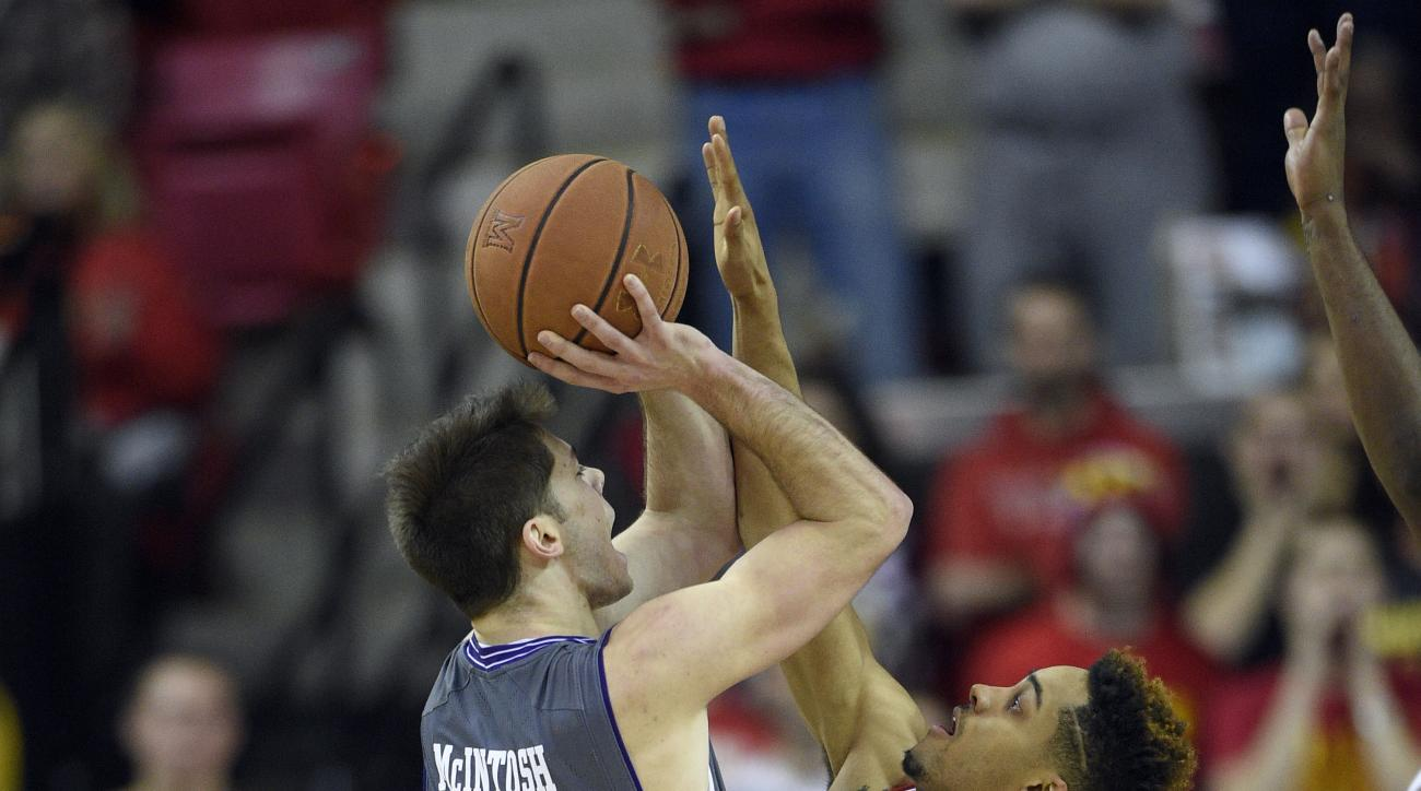 Northwestern guard Bryant McIntosh (30) goes to the basket against Maryland guard Melo Trimble, right, during the second half of an NCAA college basketball game, Tuesday, Jan. 19, 2016, in College Park, Md. Maryland won 62-56 in overtime. (AP Photo/Nick W