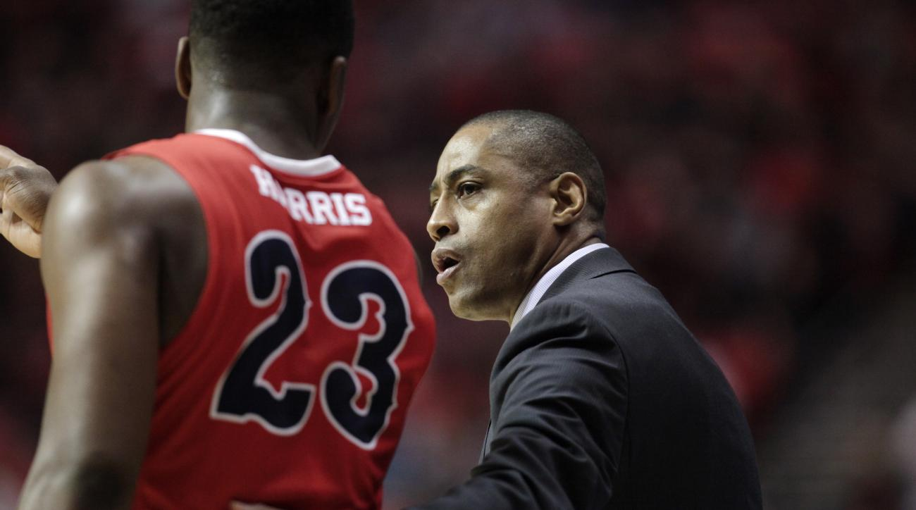 Fresno State coach Rodney Terry, right, talks with guard Marvelle Harris during the first half of the team's NCAA basketball game against San Diego State on Tuesday, Jan. 19, 2016, in San Diego. (AP Photo/Gregory Bull)