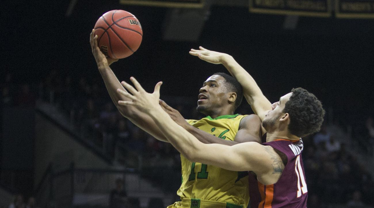 Notre Dame's Demetrius Jackson (11) goes up for a shot as Virginia Tech's Devin Wilson (11) defends during the first half of an NCAA college basketball game Wednesday, Jan. 20, 2016, in South Bend, Ind. (AP Photo/Robert Franklin)