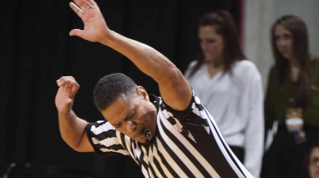 Missouri's Terrence Phillips, left, rolls into referee Michael Roberts, right, during the second half of an NCAA college basketball game against Georgia, Wednesday, Jan. 20, 2016, in Columbia, Mo. Georgia won the game 60-57. (AP Photo/L.G. Patterson)