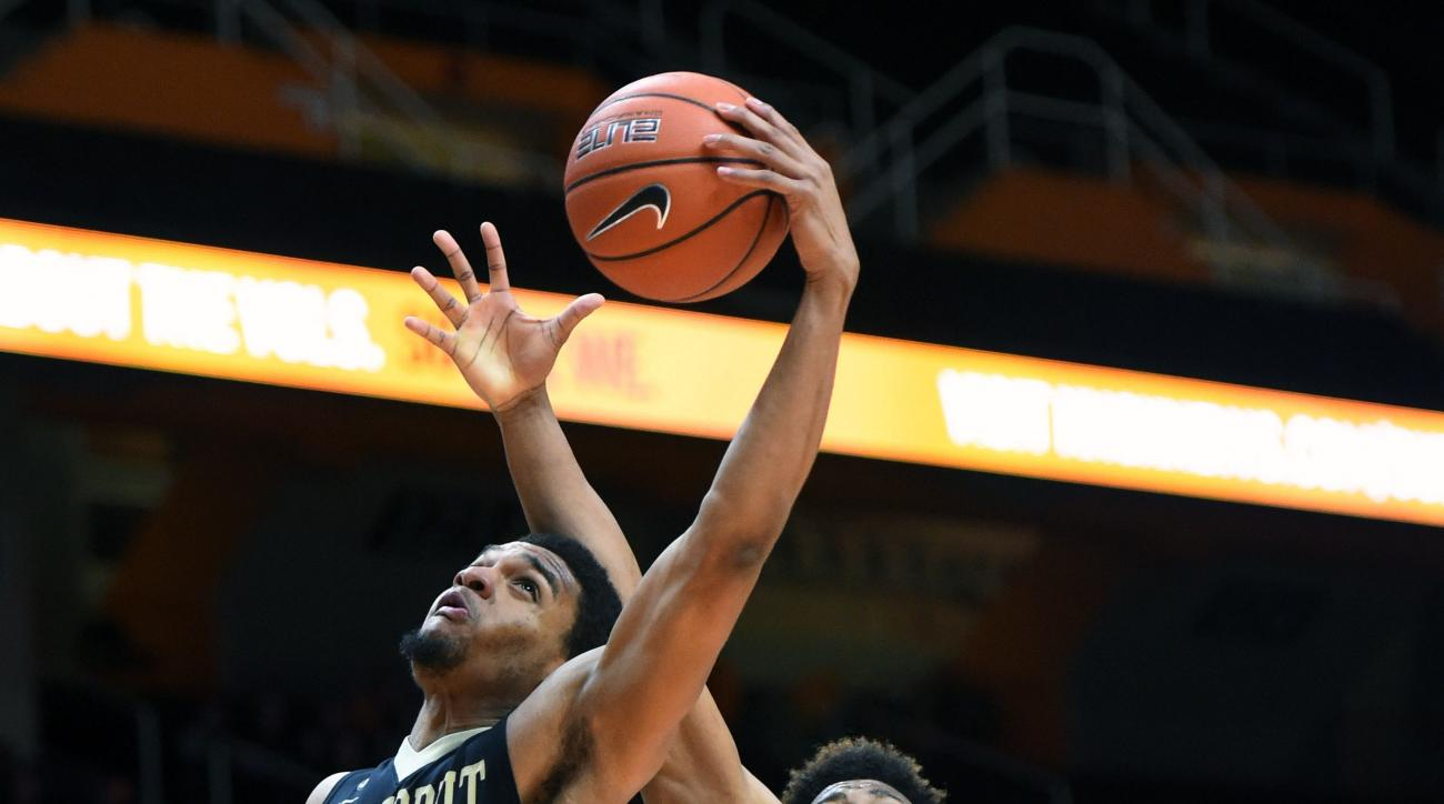 Vanderbilt forward Jeff Roberson (11) shoots a layup past  Tennessee guard Robert Hubbs III (3) during the second half of an NCAA college basketball game against Vanderbilt at Thompson-Boling Arena on Wednesday, Jan. 20, 2016 in Knoxville, Tenn. (Adam Lau