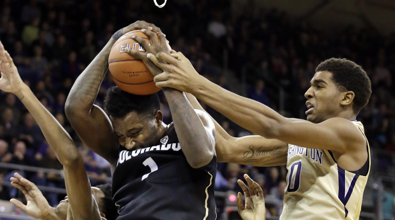 Colorado's Wesley Gordon, left, battles Washington's Marquese Chriss for possession in the first half of an NCAA college basketball game Wednesday, Jan. 20, 2016, in Seattle. (AP Photo/Elaine Thompson)