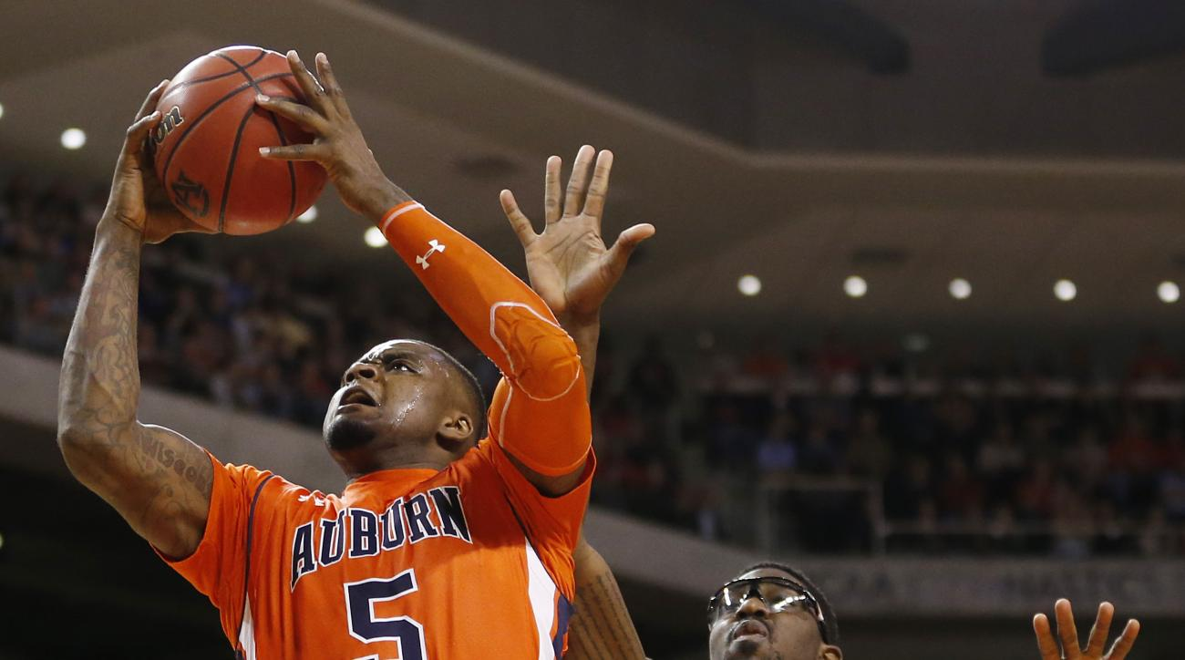 FILE - In this Jan. 16, 2016, file photo, Auburn forward Cinmeon Bowers (5) shoots and scores against Kentucky forward Alex Poythress (22) during the second half of an NCAA college basketball game, in Auburn, Ala. Bowers brings muscle and flair to Auburn,